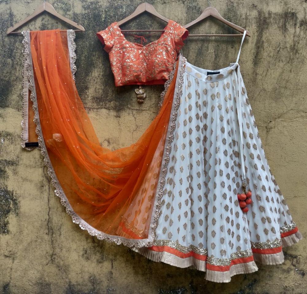 Orange and Ivory Ruffle Lehenga - Fashion Brand & Designer Priti Sahni