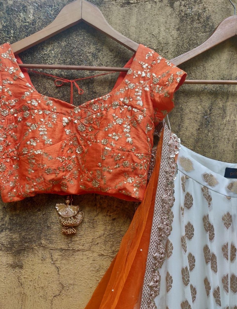Orange and Ivory Ruffle Lehenga - Fashion Brand & Designer Priti Sahni 2