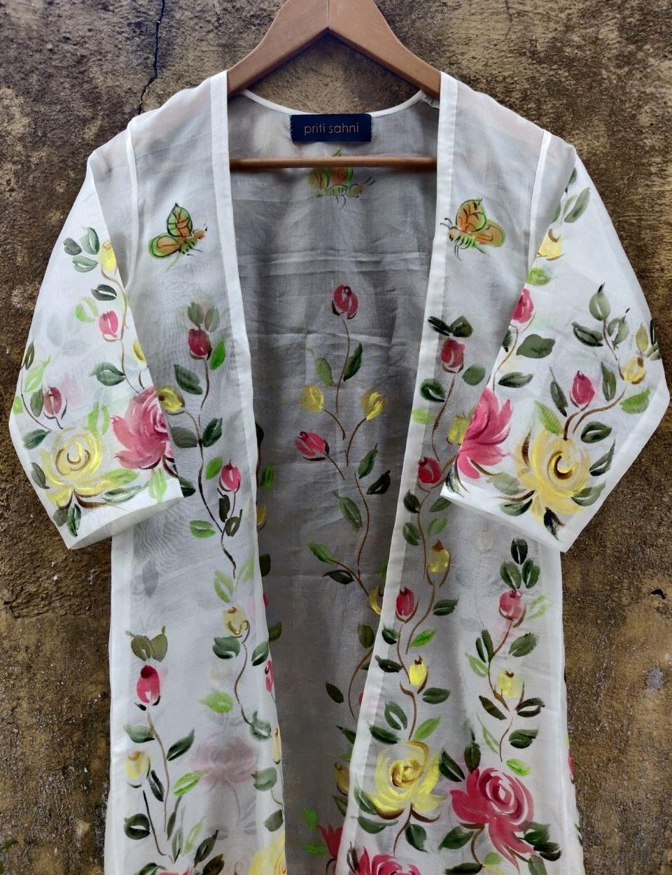 Ivory Lehenga with Hand Painted Jacket