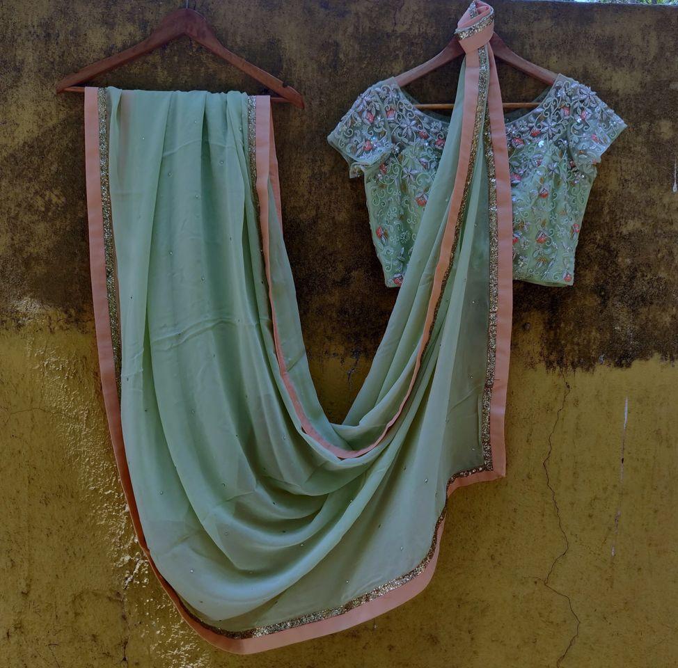 Sap Green Georgette Saree - Fashion Brand & Designer Priti Sahni