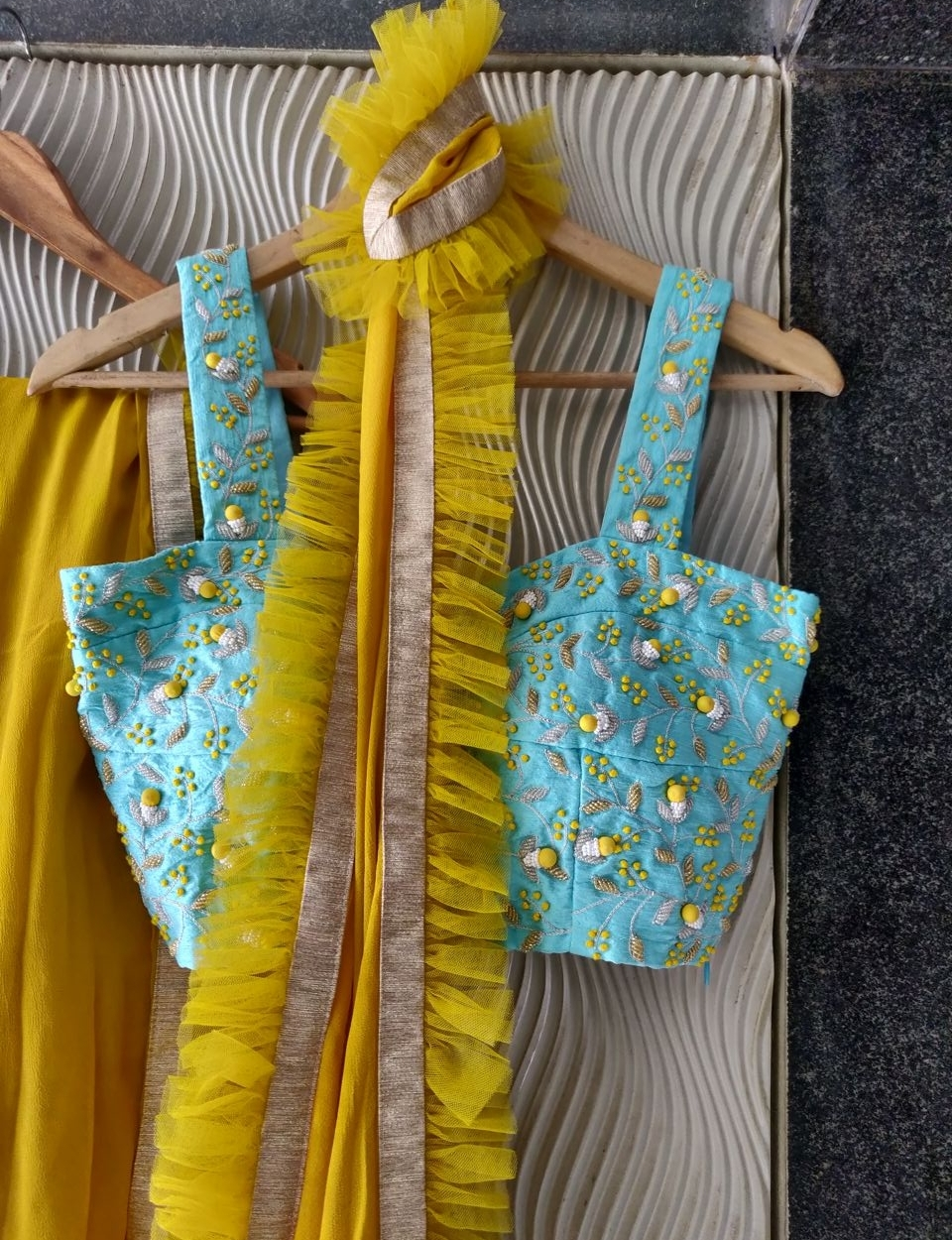 Mustard Ruffle Saree with Blue Strap Blouse