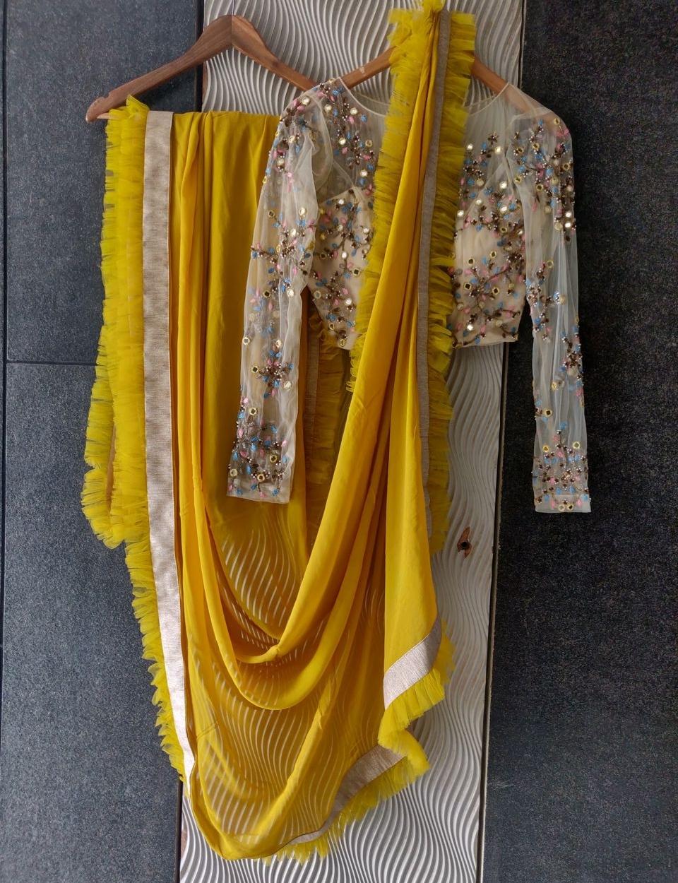 Mustard Ruffle Saree with Mirror Work Blouse