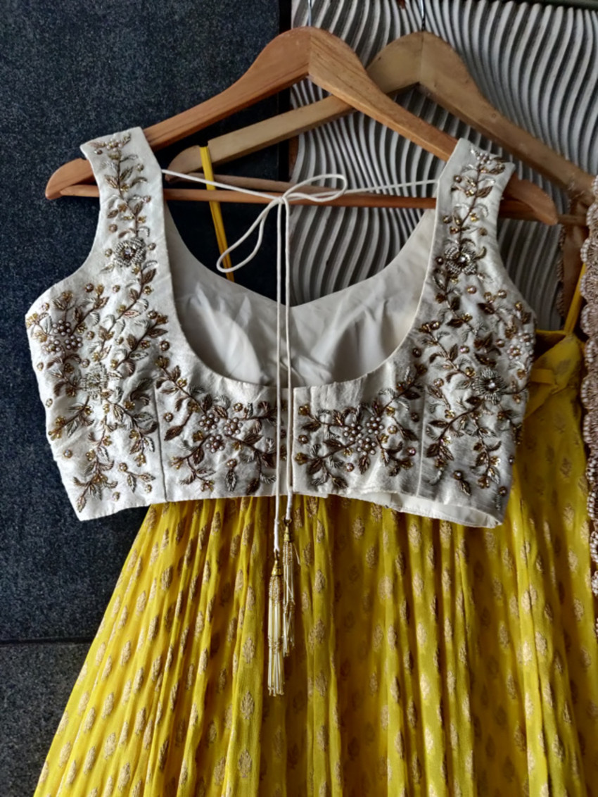 Yellow Lehenga with Ivory Raw Silk Embroidered Blouse