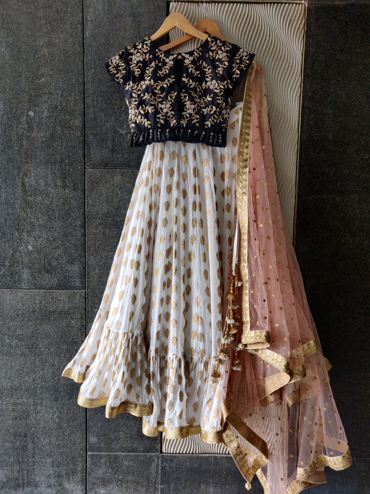 Ivory Ruffle Lehenga with Black Embroidered Blouse