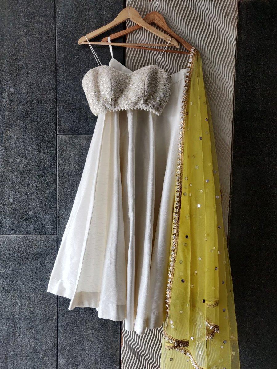 Ivory and Yellow Thread Work Bustier and Lehenga Set - Fashion Brand & Designer Priti Sahni