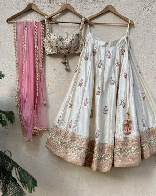 Ivory Raw Silk Lehenga with Mirror Work and Bustier Set - Fashion Brand & Designer Priti Sahni