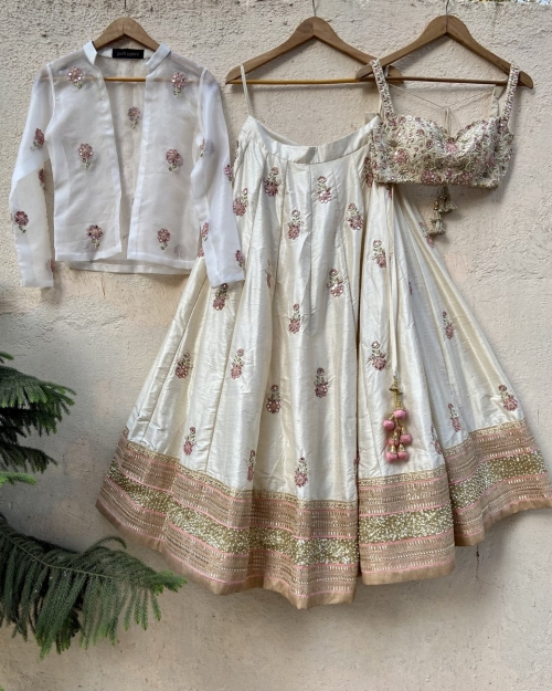 Ivory Raw Silk Lehenga with Mirror Work and Bustier and Jacket - Fashion Brand & Designer Priti Sahni