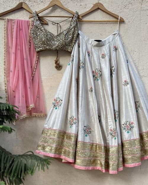 Off-White Raw Silk Lehenga with Colourful Embroidery - Fashion Brand & Designer Priti Sahni