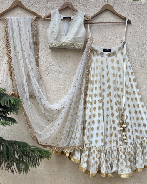 Ivory Ruffle Lehenga and Raw Silk Blouse Set - Fashion Brand & Designer Priti Sahni